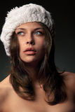 Girl in white cap Stock Image