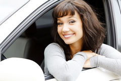 Girl in a white car. Royalty Free Stock Photos