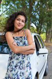 Girl and white car posing on the road Royalty Free Stock Photography