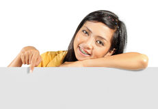 Girl and white card Royalty Free Stock Photography