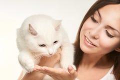 Girl white cat fur allergy. Animal asthma concept stock photos