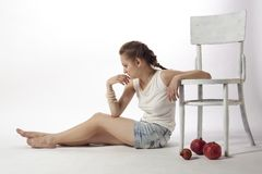 Girl and white chair Royalty Free Stock Photos