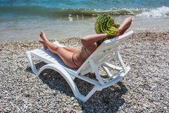 Girl on the white chaise lounge on the beach Royalty Free Stock Photos