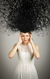 Girl in white and chaos Royalty Free Stock Photography