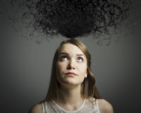 Girl in white and chaos. Stock Image