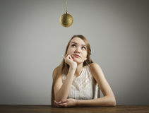 Girl in white and Christmas ball. Stock Photo