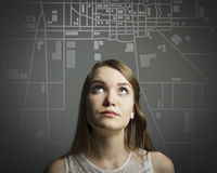 Girl in white and the city map. Stock Image