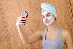 Girl with white clay beauty mask Stock Images