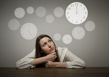 Girl in white and clock Royalty Free Stock Photos