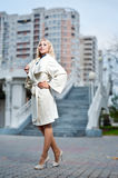 A girl in a white coat Royalty Free Stock Photo