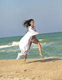 The girl in white coat at the beach Royalty Free Stock Photography
