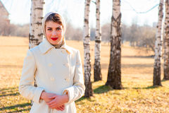 Girl in a white coat Royalty Free Stock Photos