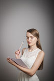Girl in white. Concentration. Stock Photo