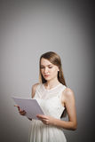Girl in white. Concentration. Royalty Free Stock Photography