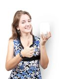 Girl with white cosmetic container. Isolated with clipping path royalty free stock photography