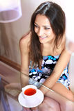 Girl with white cup of tea Royalty Free Stock Photos