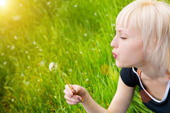 Girl with white dandelion Royalty Free Stock Images