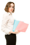 Girl in white demonstrating two folders Royalty Free Stock Photos