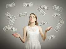 Girl in white and dollars. Stock Photos