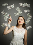 Girl in white and dollars. Stock Images