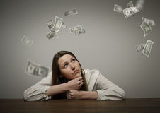 Girl in white and dollars. Royalty Free Stock Images
