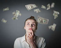Girl in white and dollars. Royalty Free Stock Photo