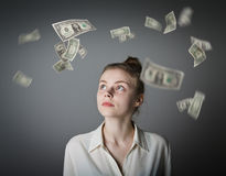 Girl in white and dollars. Stock Image