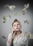 Girl in white and dollars. Royalty Free Stock Photos