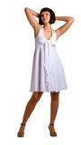 Girl in a white dress. The young beautiful girl in a white dress. Isolation on a white background Stock Photography
