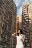 girl on the background of multi-storey buildings stock images