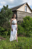 Girl in a white dress Stock Images