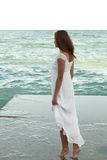 Girl in white dress on the beach. Girl in white dress on the sea beach Stock Photo