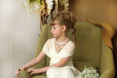 Girl  in a white dress and a beautiful necklace Royalty Free Stock Photo