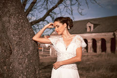 Girl in white dress. Bride in the park. Photo in vintage style. Mystery. Royalty Free Stock Image