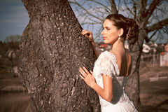 Girl in white dress. Bride in the park. Photo in vintage style. Mystery. Stock Photography