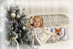 Girl in a white dress in Christmas Royalty Free Stock Photos