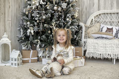 Girl in a white dress in Christmas Royalty Free Stock Photography
