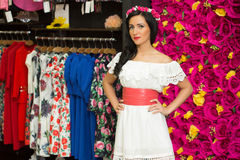 The girl in a white dress in a clothing store Stock Photography