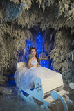 Girl in a white dress in a fairy-tale  forest Royalty Free Stock Images