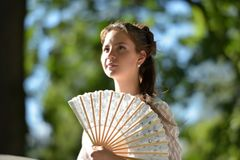 girl in white dress with fan Stock Photos