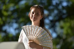 girl in white dress with fan Stock Photo