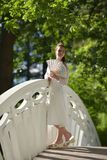 girl in white dress with fan Royalty Free Stock Images