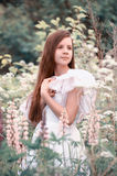 Girl in a white dress in the field Royalty Free Stock Photography