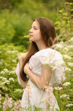 Girl in a white dress in the field Royalty Free Stock Images