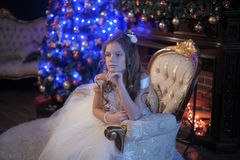 Girl in white dress in the fireplace Royalty Free Stock Photo
