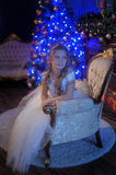 Girl in white dress in the fireplace Royalty Free Stock Photography