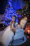 Girl in white dress in the fireplace Royalty Free Stock Image
