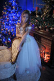 Girl in white dress in the fireplace Royalty Free Stock Photos