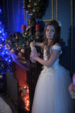 Girl in white dress in the fireplace Royalty Free Stock Images
