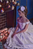 Girl in a white dress by the fireplace at christmas Royalty Free Stock Photography